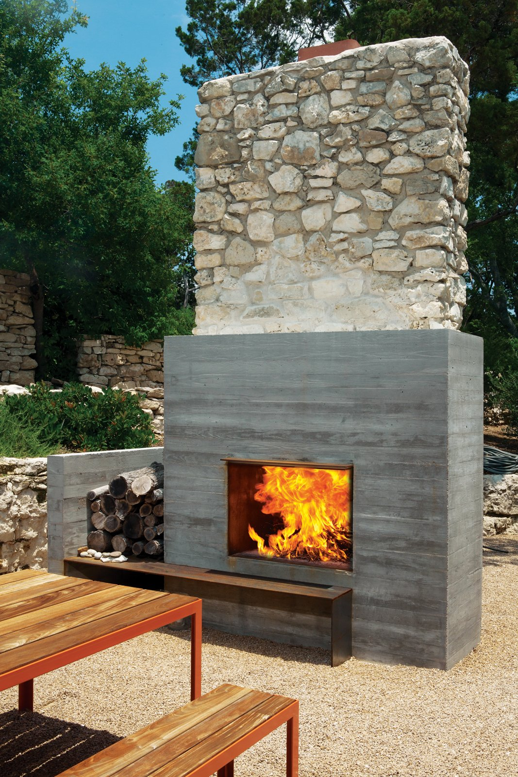 Outdoor and Back Yard The outdoor fireplace is one of the few remnants of the original structure.  97+ Modern Fireplace Ideas from Texas Two-Step