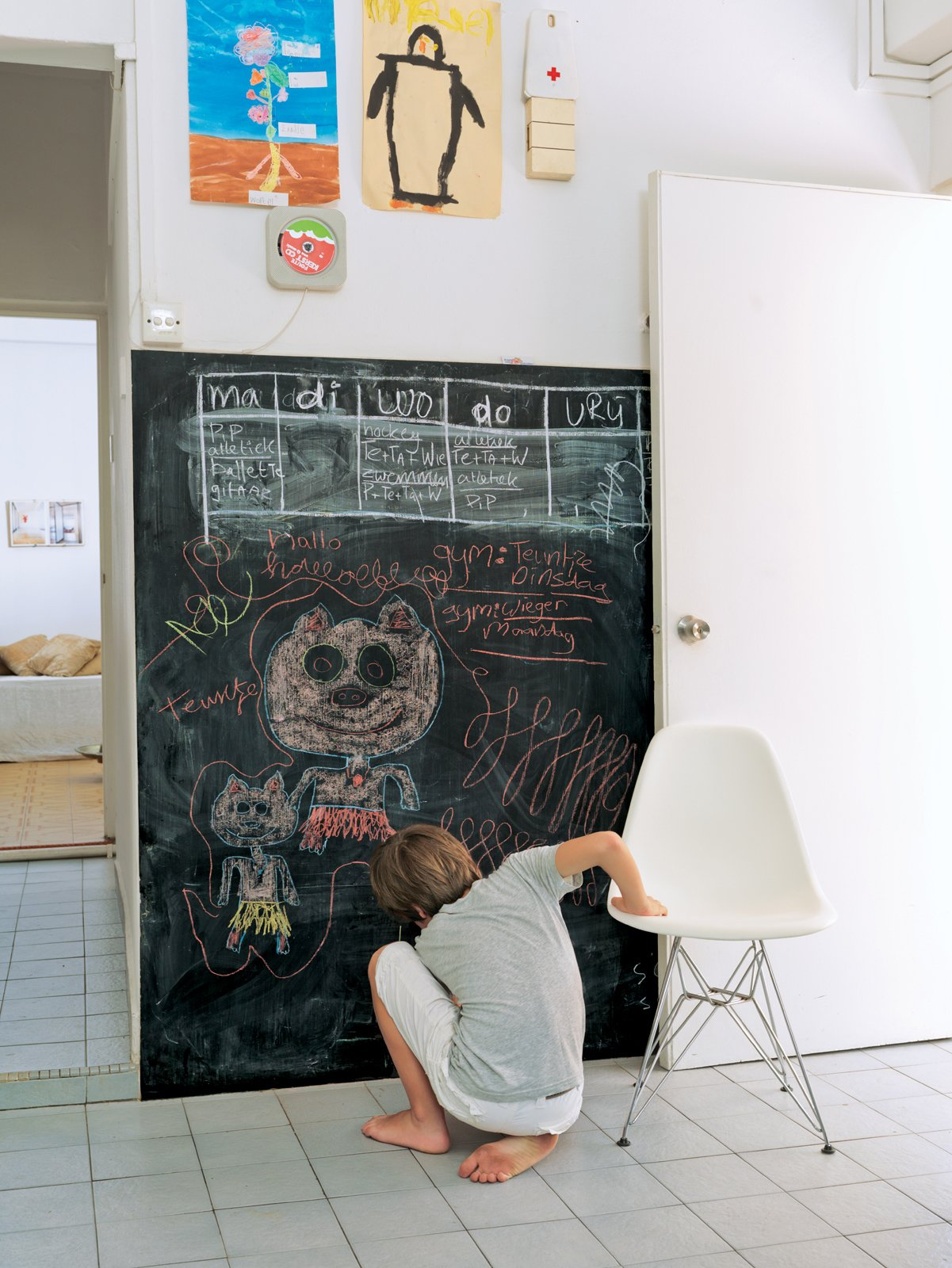 Living Room and Chair De Waart added a chalkboard to the kitchen for writing memos and for drawing, as Tammo does here.  Chalkboard Walls in Kitchens and Kids' Rooms by Jaime Gillin from A Family Moves from Netherlands to Singapore