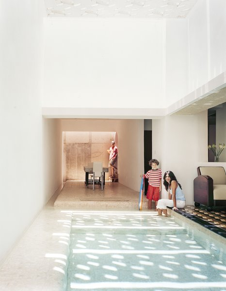 The dining area feels like an extension of the pool, with water channels on two sides.  Photo 8 of 13 in 12 Perfect Plunge Pools For Your Small Outdoor Space from San Juan, PR