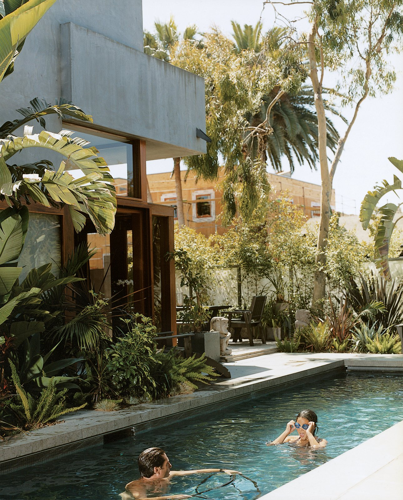 Outdoor and Small Pools, Tubs, Shower Sophie and Colin enjoy their new pool, the only non-solar-powered portion of their home in Venice, California, created by their father, architect David Hertz. Read the full article here.  Photo 4 of 6 in Sustainability in Stages