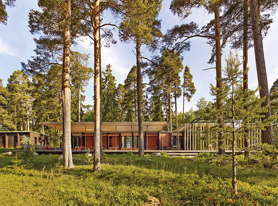 Exterior, Flat RoofLine, Wood Siding Material, and House Building Type The pine forest around the complex provided the architects with their color scheme.  Photo 5 of 8 in How a 1,000-Year-Old Technique Made This Pavilion