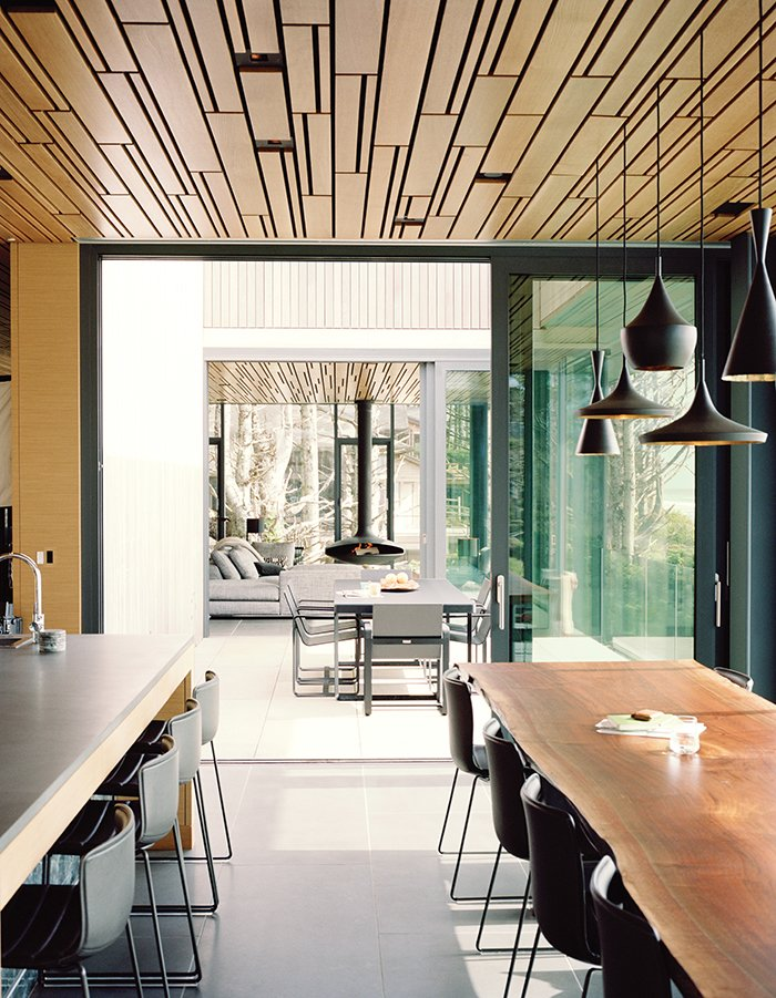Dining, Lamps, Chair, Pendant, Stools, Bar, and Bench In this Portland home, design firm Made arranged individually carved white-oak planks in a geometric pattern on the ceiling that repeats itself throughout the house. Beat Light pendant lamps by Tom Dixon hang above a custom dining table, also by Made.  Best Dining Lamps Stools Photos from Glass House with Stunning Pacific Ocean Views