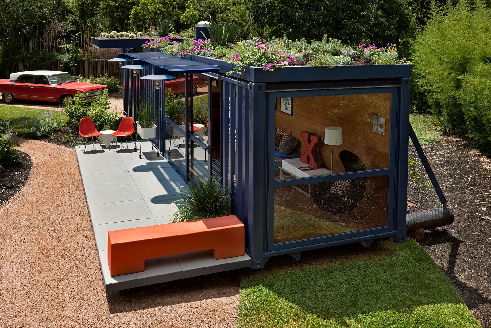 Jon Ahrens of Madrone Landscaping, who layed out the plantings around the container, implemented a green roof on a drip watering system. The cantilevered overhang at rear is planted with cacti.  Shipping Containers by Dwell