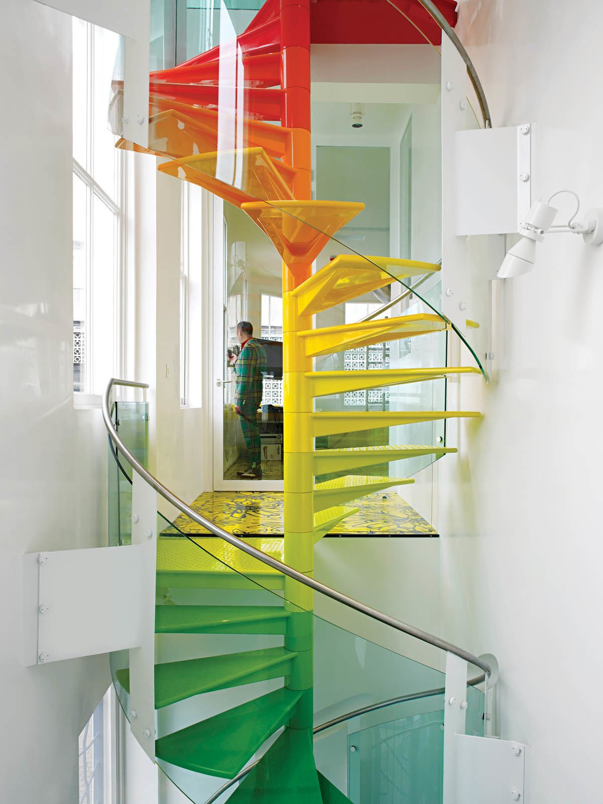 Staircase, Metal, and Metal Ab Rogers dons a bold suit that suits the spirit of the accompanying decor he designed.  Best Staircase Photos from A Family Goes Somewhere Over the Rainbow