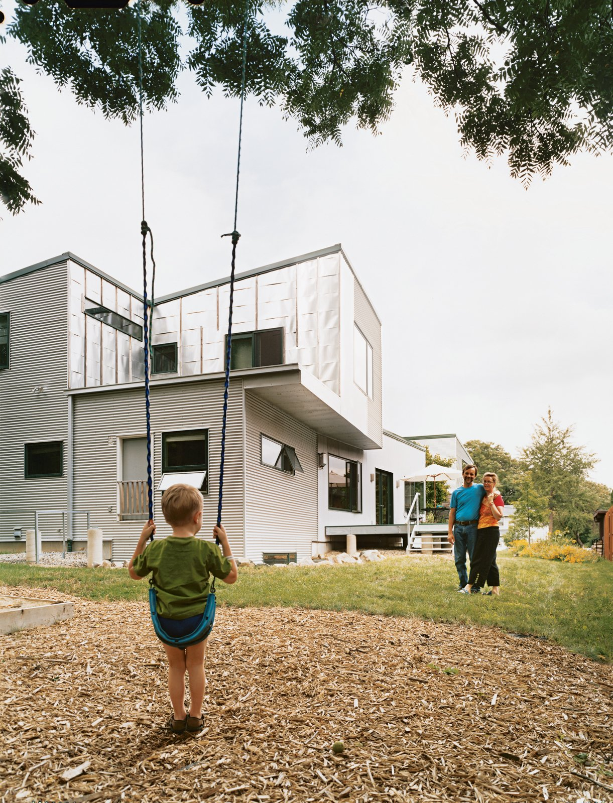 Tom McMurtrie and Genia Service with their five-year-old son, Gary.  20 Best Modern Homes from the Midwest by Erika Heet from Steel and Magnolias