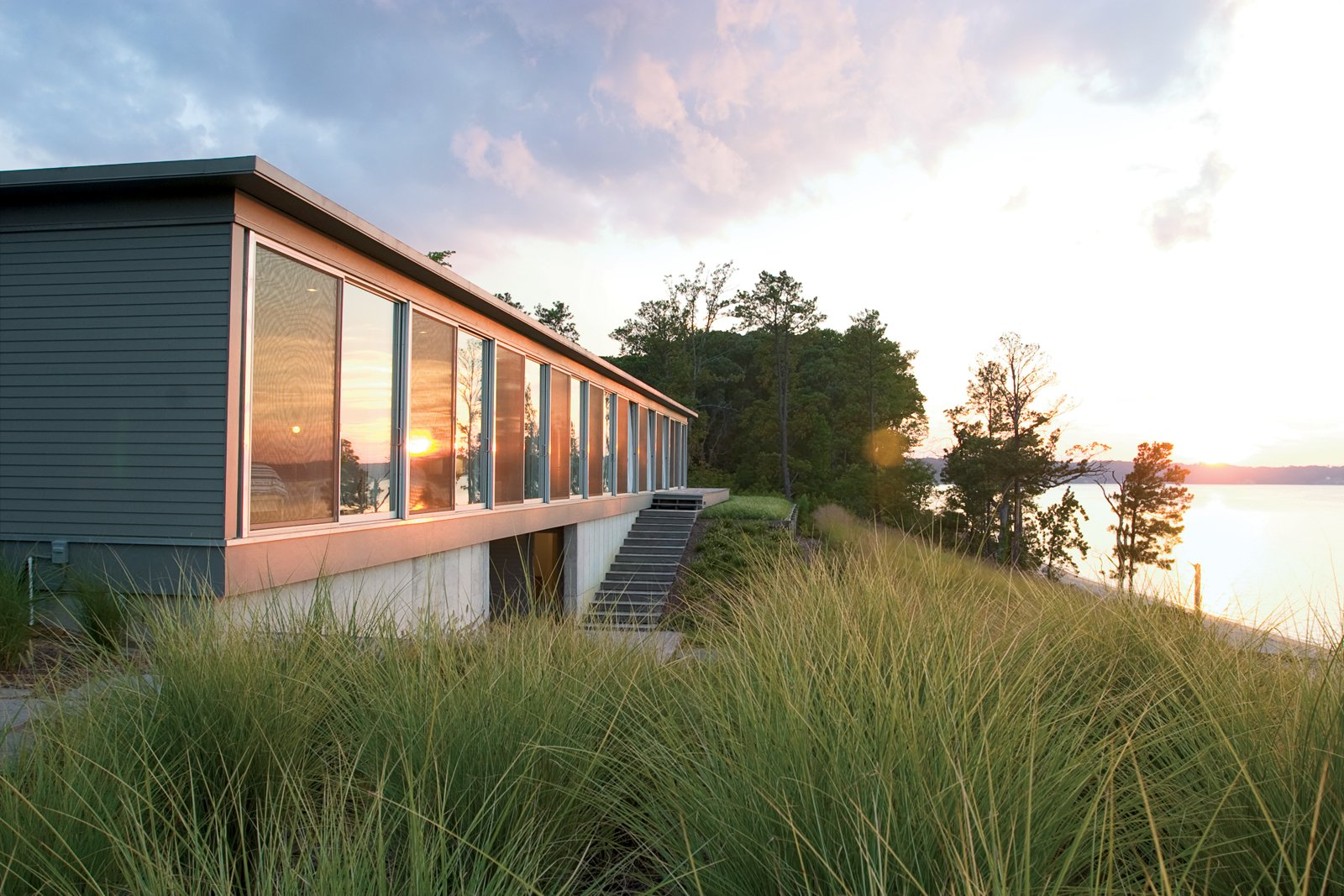 "Exterior, House Building Type, Wood Siding Material, Concrete Siding Material, and Metal Siding Material Ziger/Snead Architects constructed this ode to rowing in rural Virginia for a Baltimore couple who share a love of sculling. ""Everywhere in the house you can see the moment where land meets water,"" says Douglas Bothner, an associate at the firm.  Homes with a Waterfront View by Diana Budds from Row House"