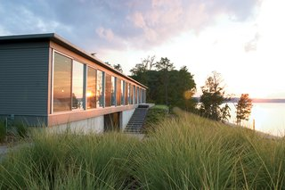 "Ziger/Snead Architects constructed this ode to rowing in rural Virginia for a Baltimore couple who share a love of sculling. ""Everywhere in the house you can see the moment where land meets water,"" says Douglas Bothner, an associate at the firm."