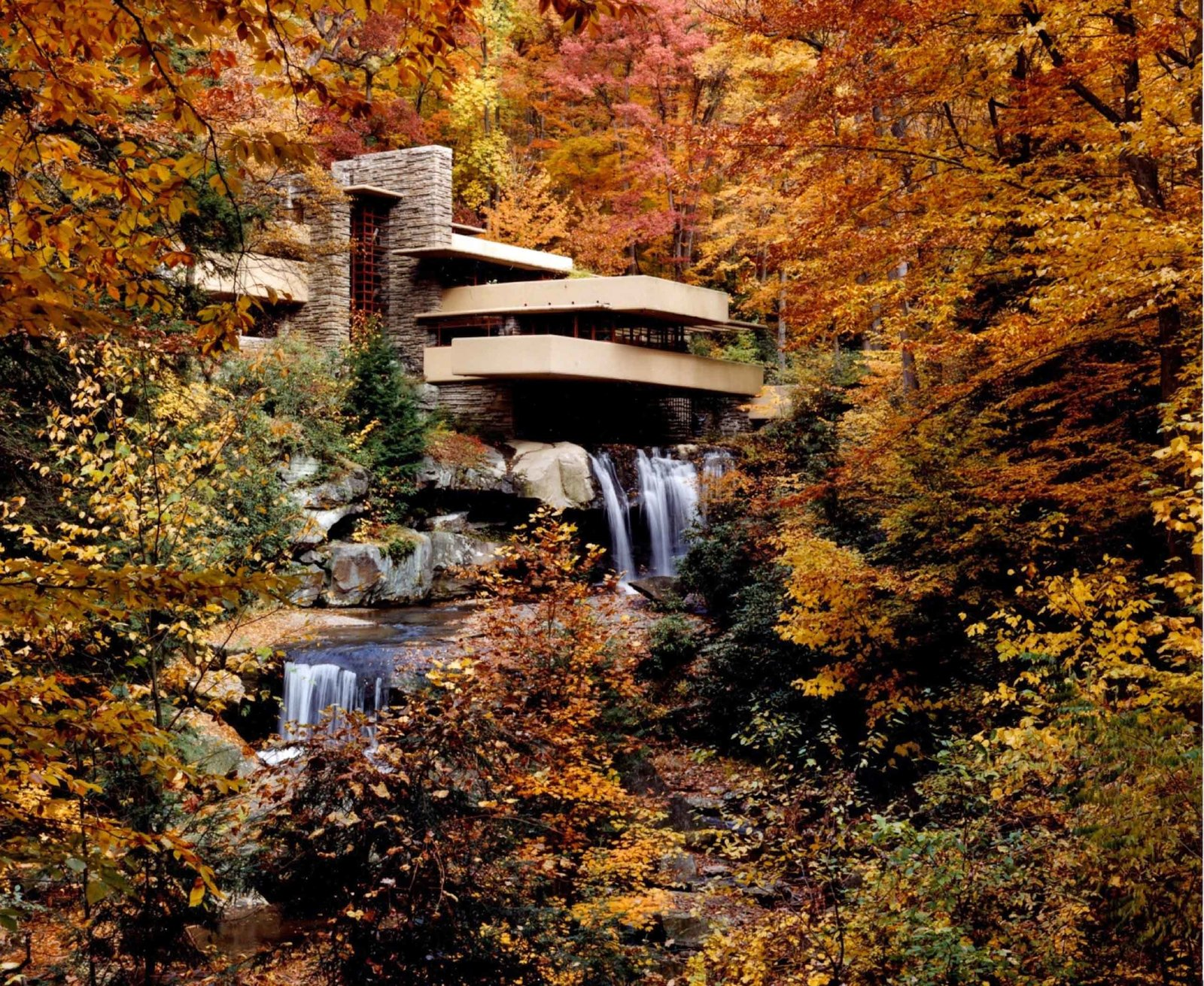 Exterior, Metal Siding Material, Concrete Siding Material, House Building Type, and Glass Siding Material Fallingwater (1935, Mill Run, Pennsylvania). The legendary Fallingwater residence, a masterpiece in concrete, steel, and glass, is built with three levels that project over a 30-foot waterfall.  Iconic Frank Lloyd Wright Buildings by Allie Weiss
