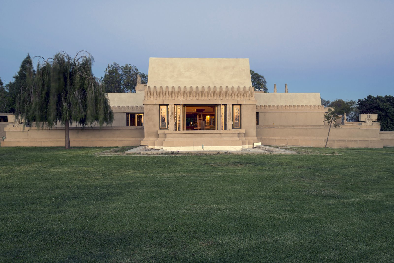 Hollyhock House (1918, Los Angeles, California). This residence, the architect's first commission in Southern California, revolves around a central patio and contains multiple rooftop terraces.  Iconic Frank Lloyd Wright Buildings by Allie Weiss