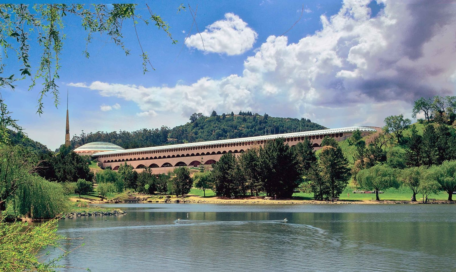 Marin County Civic Center (1957, San Rafael, California). Wright's design for the Marin County Civic Center blends into the surrounding hills, and even bridges over two with a series of arches.  Iconic Frank Lloyd Wright Buildings by Allie Weiss