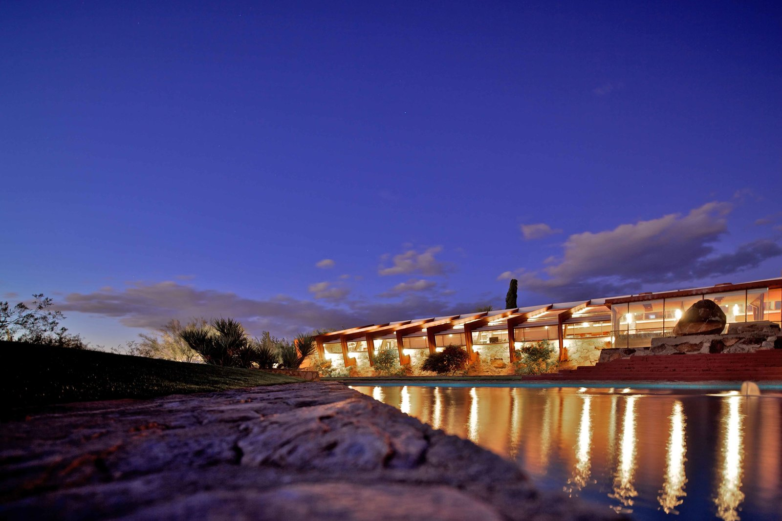 Taliesin West (1938, Scottsdale, Arizona). Wright experimented with architectural techniques on his winter home and studio over the course of two decades. He developed a stone masonry out of boulders and rocks found around the site. The property houses the offices of the Frank Lloyd Wright Foundation; the resident staff and students who live and work at Taliesin and Taliesin West; and the Frank Lloyd Wright School of Architecture.  Iconic Frank Lloyd Wright Buildings by Allie Weiss