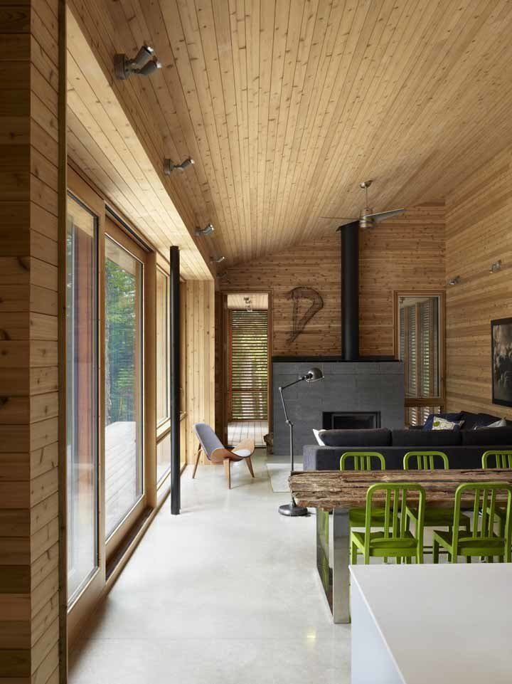 The cabin was designed so that the north half can be closed off when not in use to reduce energy consumption. When the northern half is closed, the radiant floor heating can be turned off and the main area can be heated by the high efficiency wood fireplace. Photo by Shai Gil.  Stealth Cabin by Kelsey Keith