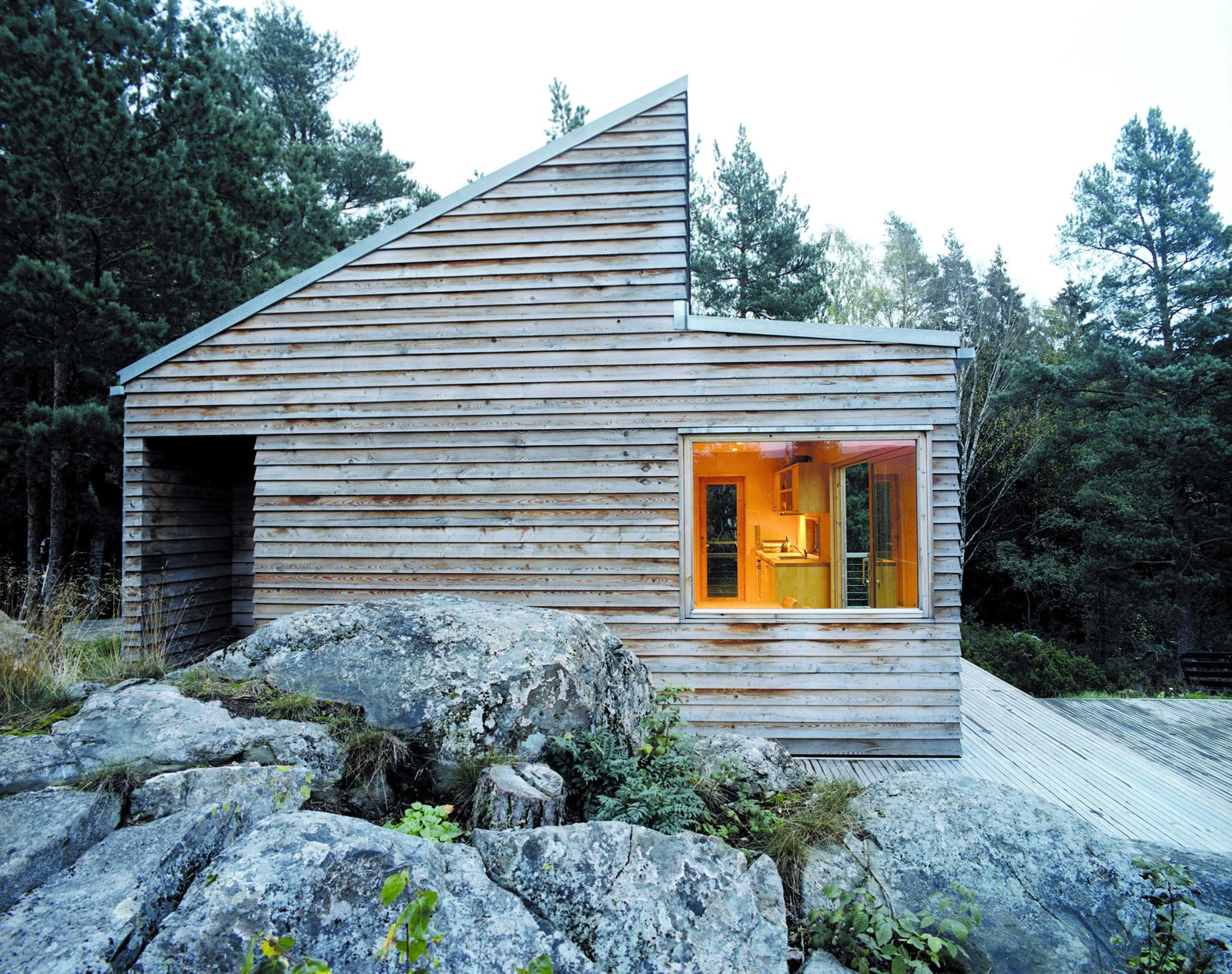 Outdoor, Wood, House, Boulders, Side Yard, Large, and Wood Woody35's distinct shape makes it stand out from its surroundings despite the modest size of the building.  Best Outdoor Large House Photos from A Prefab Cabin in Norway