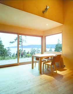 The cabin's living room area opens up to the surroundings. Walls and ceiling are clad in birch veneer while the floor is in solid birch.