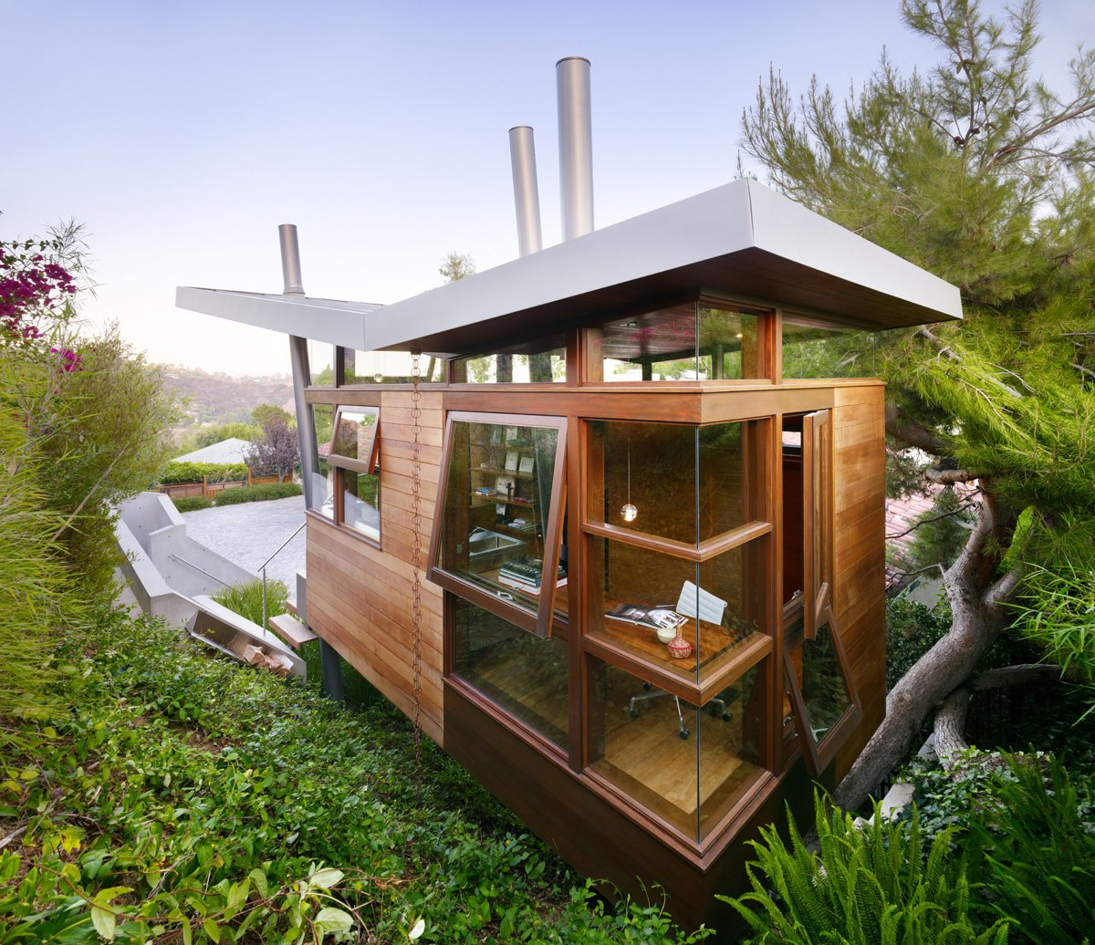 Exterior, Butterfly, House, Cabin, and Wood Large floor-to-ceiling windows and doors provide abundant natural light and ventilation.  Best Exterior Butterfly Cabin Photos from An Atypical Tree House