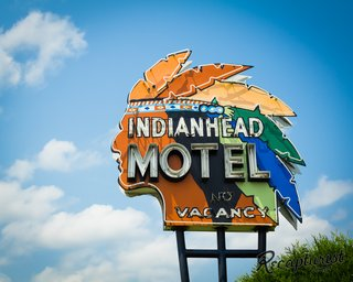 "One of Rose's favorite signs belongs to the Indianhead Motel in Chippewa Falls, Wisconsin. ""The colorful headdress on this one—repainted as recently as 2008—is even more stunning in person,"" he says. ""Thanks to help from the local historical society, I was able to trace its origins back to 1958 when a man named Ernest Cote first opened the motel."""
