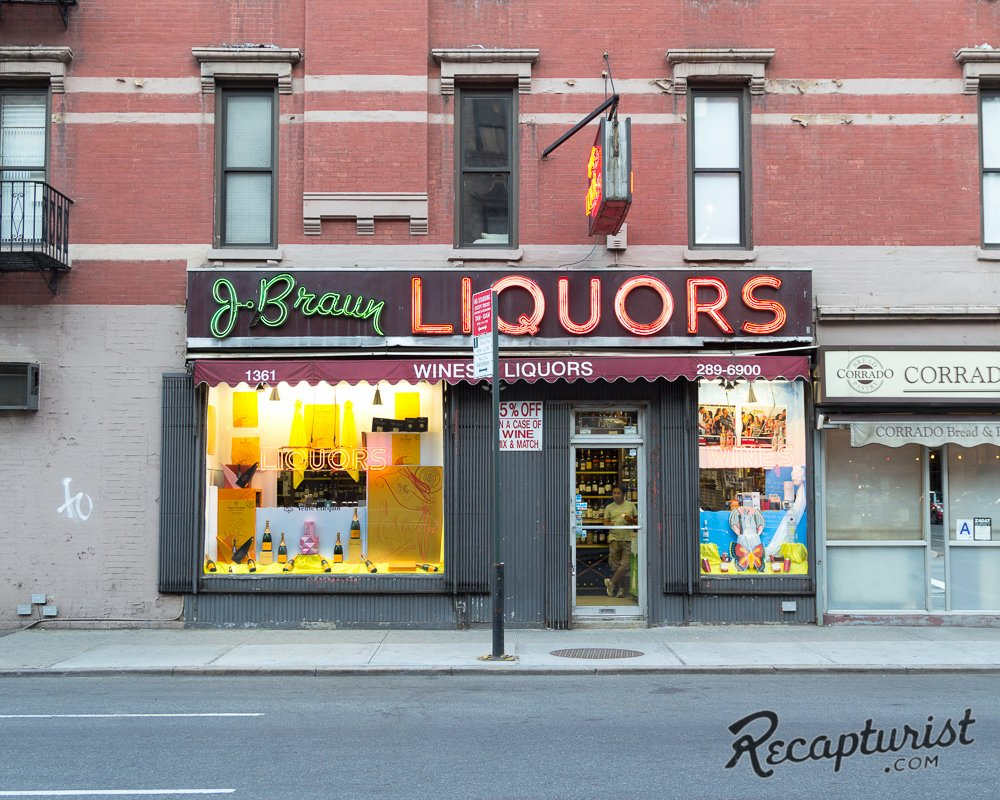 """In addition to signs, Rose documents storefronts, like J. Braun Liquors in New York City. """"Julius Braun was a Jewish immigrant who arrived in the United States from Poland with his family in 1921,"""" he writes. """"He was only seven years old at the time. City records indicate that the neon signage was installed in 1952. When Mr. Braun passed away in 1995, the store was sold to new owners who, despite changing the business name to 'Uptown Wine Shop', never updated the signage out front. No complaints here.""""  Photo 5 of 9 in These Amazing Vintage Signs Are a Blast from America's Past"""