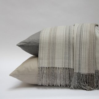 JACK NEUTRAL THROW  and settle in on the couch with a cozy throw blanket.