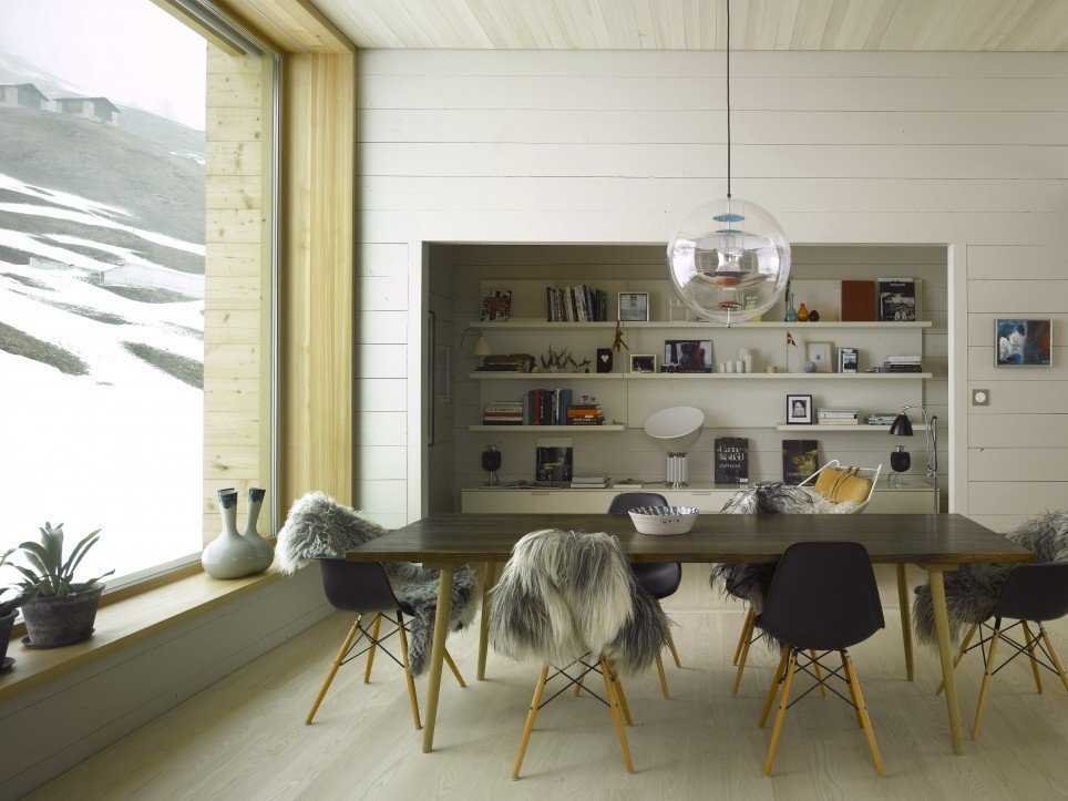 The interiors at Brüke 49 are composed of eclectic Scandinavian styles combined with pieces farmers who previously occupied the house left behind. Photo by Martin Guggisberg via Bergdorf AG.  Modern Winter Retreats from A Contemporary Alpine Retreat in Switzerland