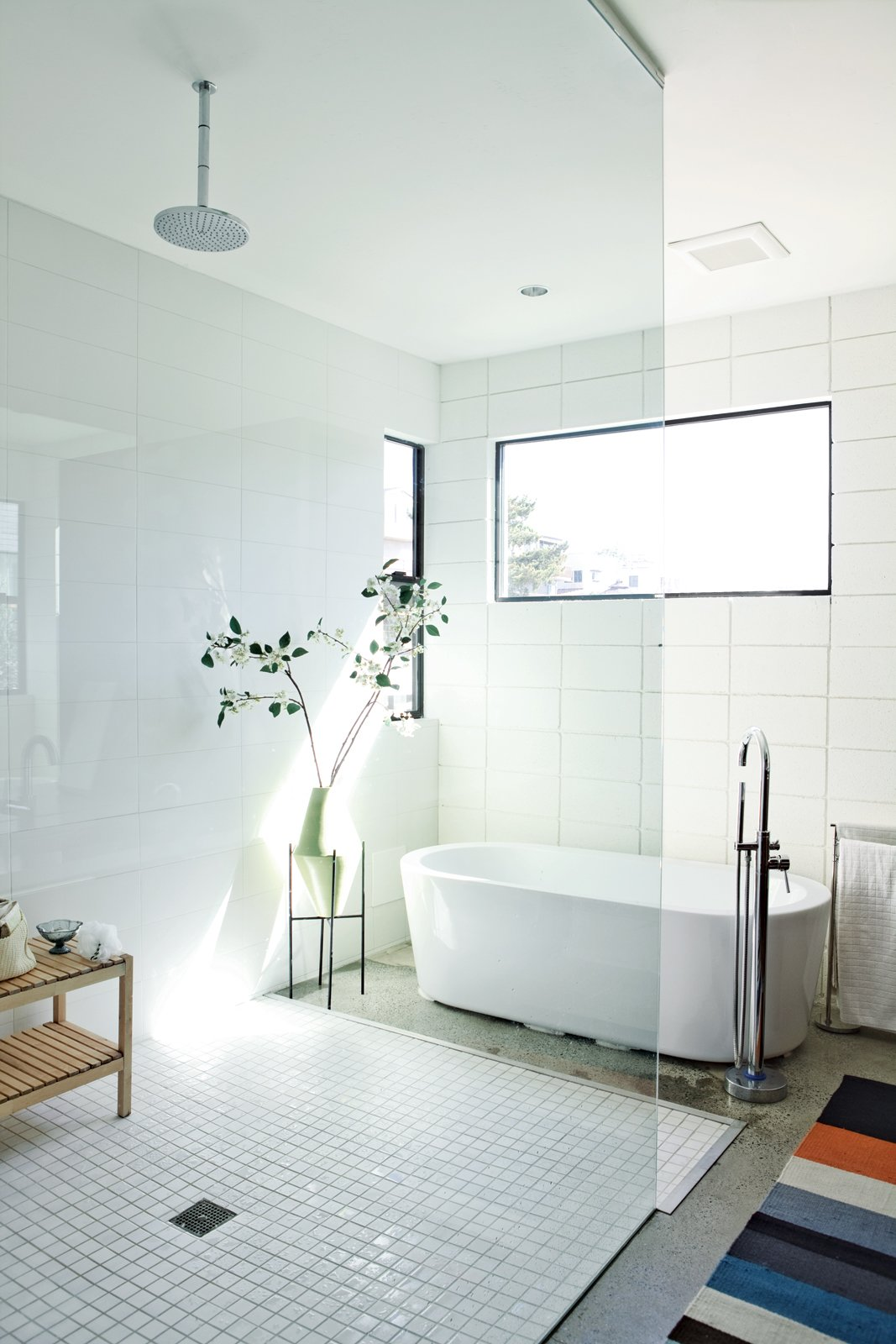 Bath, Freestanding, Open, Recessed, Rug, and Concrete Part of a 1,000-square-foot space the brothers designed for their parents, the master bath features a Whittington Marlon bathtub from Signature Hardware.  Best Bath Rug Open Photos from The First LEED Gold-Certified Family Home in San Diego