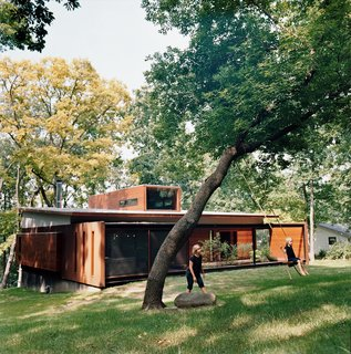 Maintaining a connection to their wooded backyard was an important consideration for the Edstorms. The back wall is designed to let in as much light and air as possible. Read more about this spacious renovation here.