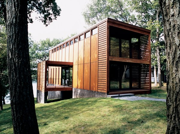 Milwaukee studio Vetter Denk Architects designed this eye-catching prefab on the banks of Moose Lake, Wisconsin, as a weekend retreat.   The home was based on an idea presented by the home's owner, who was inspired by a screw-top jug of $9.99 red wine.