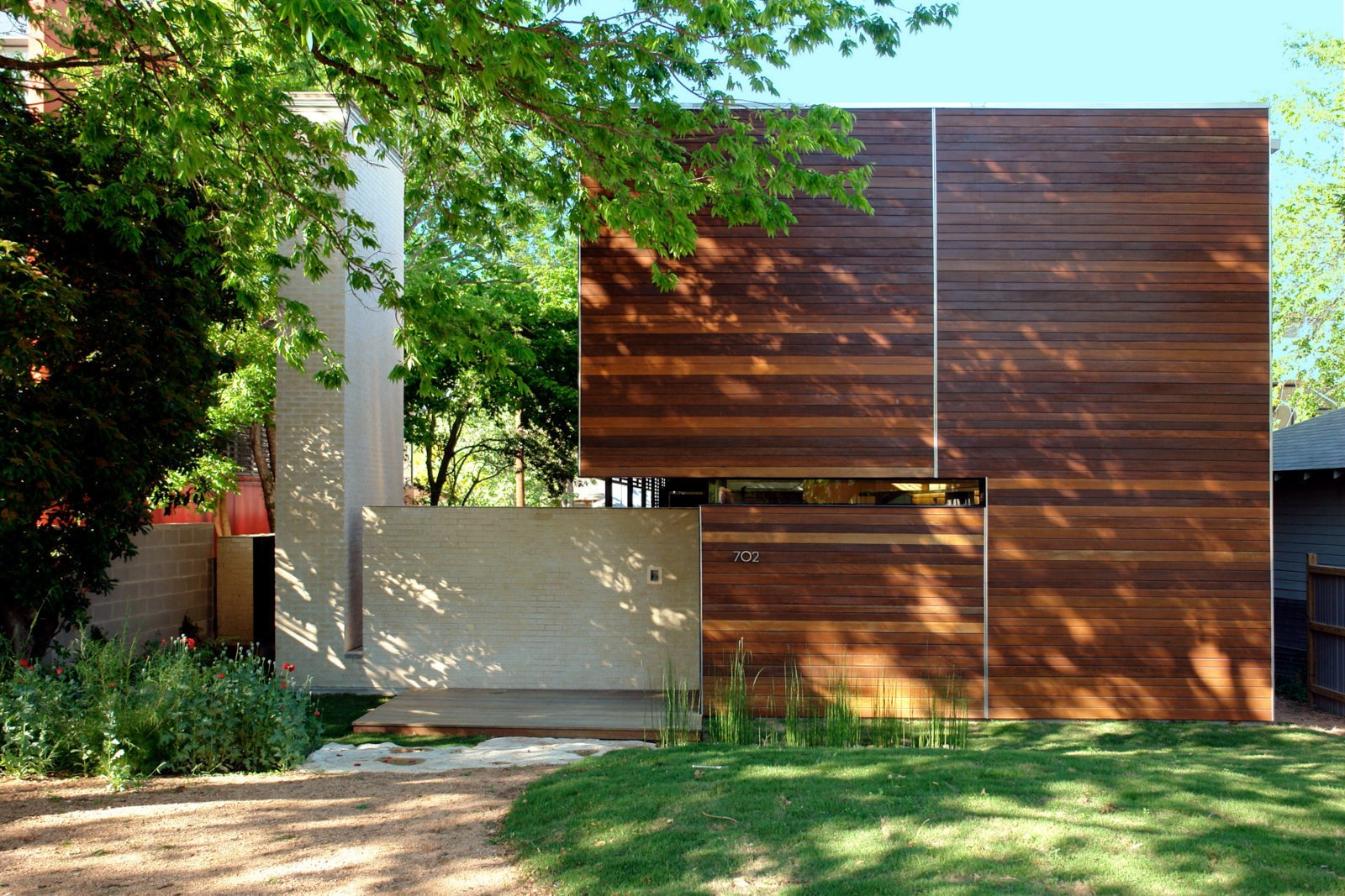 Homeowners Alex Wolfe and Jamie Thorvilson recently moved into the Wolfe Den, which sits on a quiet residential block in Austin. The facade, clad in massarunduba hardwood sourced from a managed forest supplier, strikes a sharp modern chord but still echoes the painted wood siding on many of the neighboring homes.  Reasons to Love Austin, Texas by Erika Heet from Unique Houses in Austin, Texas