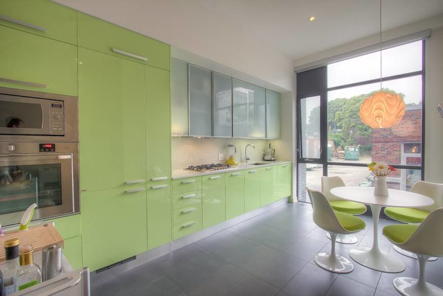 """The kitchen in Shane Carslake's Corktown townhouse was modern, but with lime-green cabinets, a tile floor, and inefficient layout, it didn't fit his needs. A real estate agent by trade, Carslake knew a renovation would pay off in spades. """"Changing the kitchen enhanced the feeling of my entire home and made it an even more pleasurable place to hang out,"""" he says. """"bulthaup was an investment, however, I'm confident it will pay off if I decide to sell.""""  Search """"limegreen"""" from You Have to See the Before Shot of This Refined, Minimal Kitchen"""