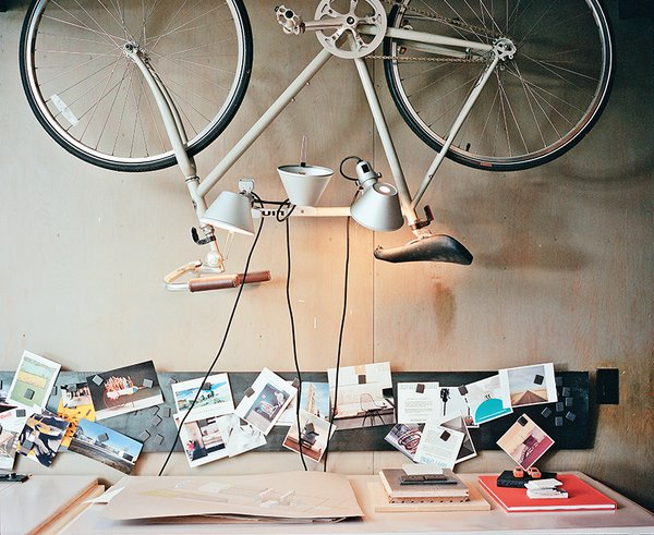 One of the bedrooms became Norelius's studio, which includes lighting from Artemide above a custom desk.