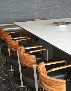 The Antonio Citterio walnut-back Morgan chairs are also from Flexform.