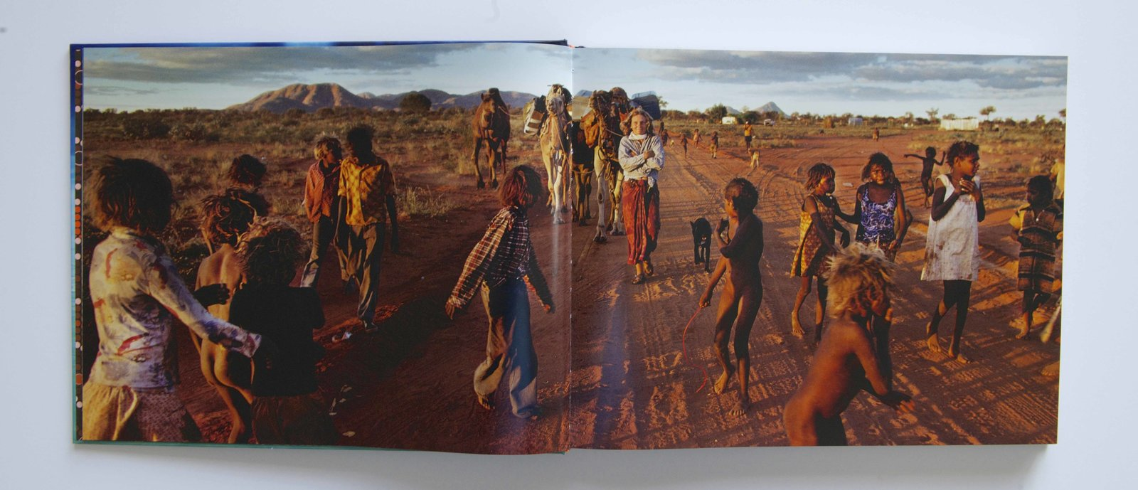 A spread from Inside Tracks featuring Smolan's photograph of Davidson in the Australian outback.  Photo 1 of 3 in Travel Across the Australian Outback with This Book