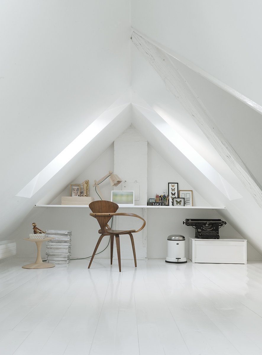 Office, Study Room Type, Chair, Desk, and Painted Wood Floor A vaulted loft room complete with a typewriter and natural wood furnishings serves as the perfect hidden workspace. The chair is a vintage Cherner chair, the side table is Nanna Ditzel, and the wood lamp is a Muuto Wood model.  Loft