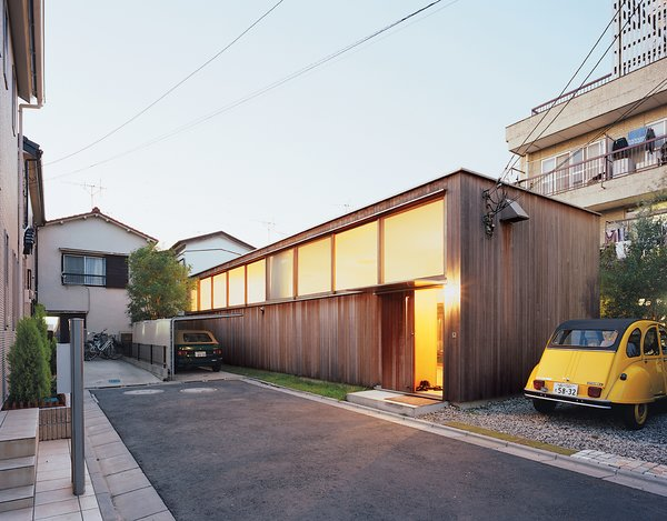 Exterior, Wood Siding Material, House Building Type, and Flat RoofLine Large clerestory windows face the street at the Higashibatas' house in Tokyo, optimizing both privacy and natural light within.  Unique Tokyo-Based Architects by Kate Santos from Family Style