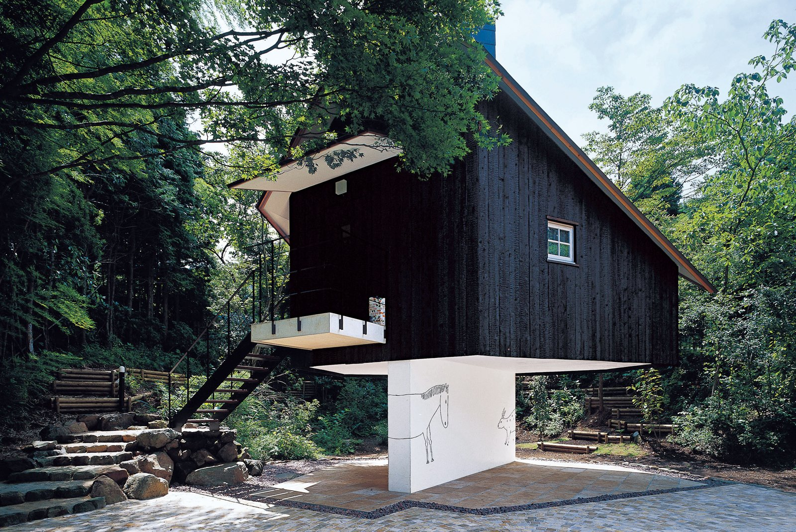 Fujimori has an affinity for building structures that appear to be perched precariously: His charred cedar-clad Guest House seems to balance on a sliver of a wall.  Unique Tokyo-Based Architects by Kate Santos from Terunobu Fujimori