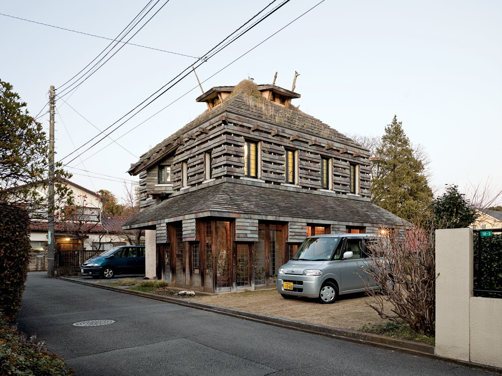 """Fujimori designed his own residence, the Tanpopo House, in 1995, with volcanic rock siding and grass and dandelions on the roof and walls; he is pleased by its """"bushy-haired expression.""""  Photo 7 of 23 in Terunobu Fujimori"""