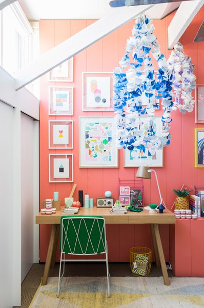 The kids' room is especially vibrant, with Tango-painted walls by Delux, artwork by Rachel Castle and Beci Orpin, handmade beaded chandeliers by Emily Green, and a kicky pineapple lamp by Down to the Woods. Photo by Phu Tang.