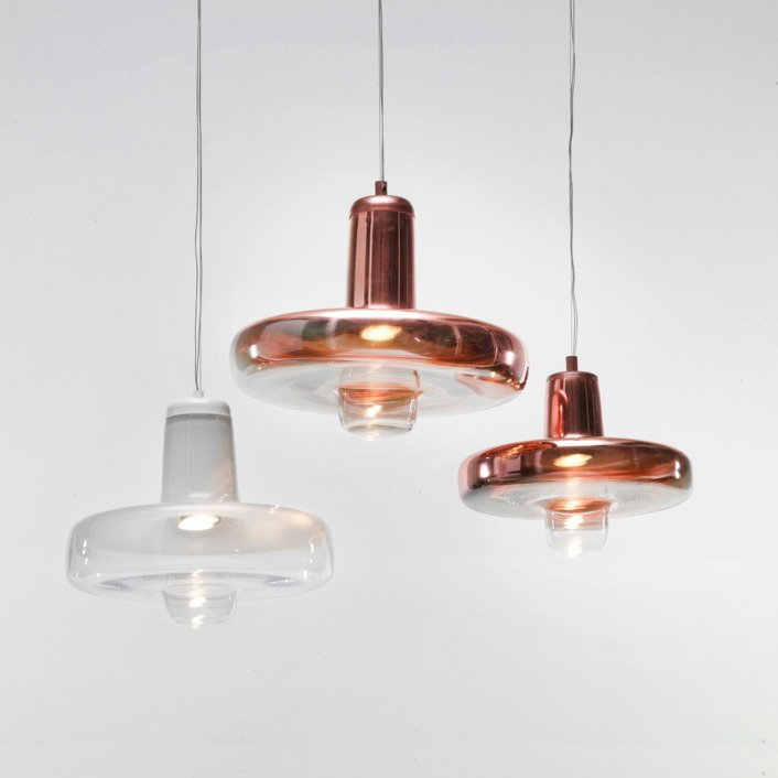 The Spin light is made in varying sizes and comes in both transparent and copper coated glass.  Lighting Fixtures by Lucie Koldova by Jami Smith