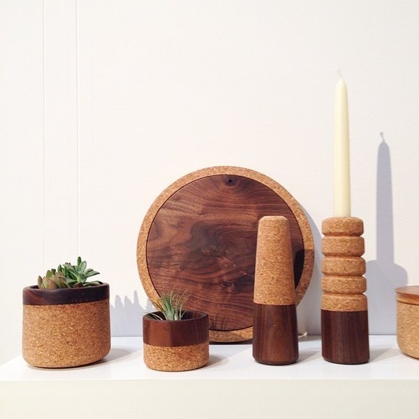 Hand-turned candlesticks, planters, and serving board made from wood and cork by Oakland-based designer and maker Melanie Abrantes.