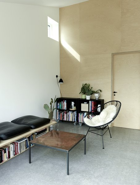 """High windows on the east and west façades catch the sunrise and sunset, increasing light within the home. """"They're very simple and lo-fi,"""" Larsen says.  Interiors from Danish Prefab Feels Much Larger Than Its 861 Square Feet"""