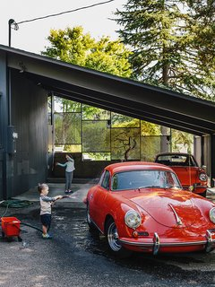 Lilyvilla Gardens built custom wood and concrete steps connecting the street to the house, which flow into an exposed patio under the refurbished carport. In addition to collecting midcentury furniture, Ty Milford is a vintage car aficionado and owner of two cherry red Porsches.