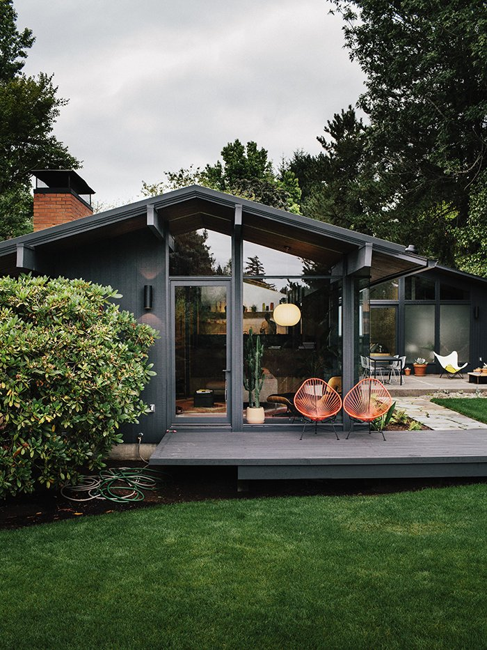 Exterior, Mid-Century Building Type, and House Building Type The exterior sconces are original to Zaik's 1956 design. JHID rebuilt the rear deck off the living room, which connects to an aggregate patio; the two architectural elements are connected by pathways in variegated bluestone designed by Lilyvilla Gardens.  Modern Landscaping from Midcentury Renovation in Portland Capitalizes on Nature with Seven Doors to the Outside