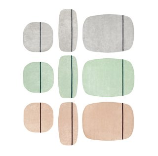 Oona carpets by Simon Legald for Normann Copenhagen, $310–$690. The handtufted New Zealand wool carpets are available in three sizes and three colors (all shown) and feature an accent stripe with a shorter pile height.