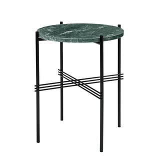 TS table small by GamFratesi for Gubi, $659. Marble tabletops have long been a furniture mainstay, but, in a twist, Danish-Italian designers GamFratesi used the exotic Verde Guatemala strain atop the glossy black base.