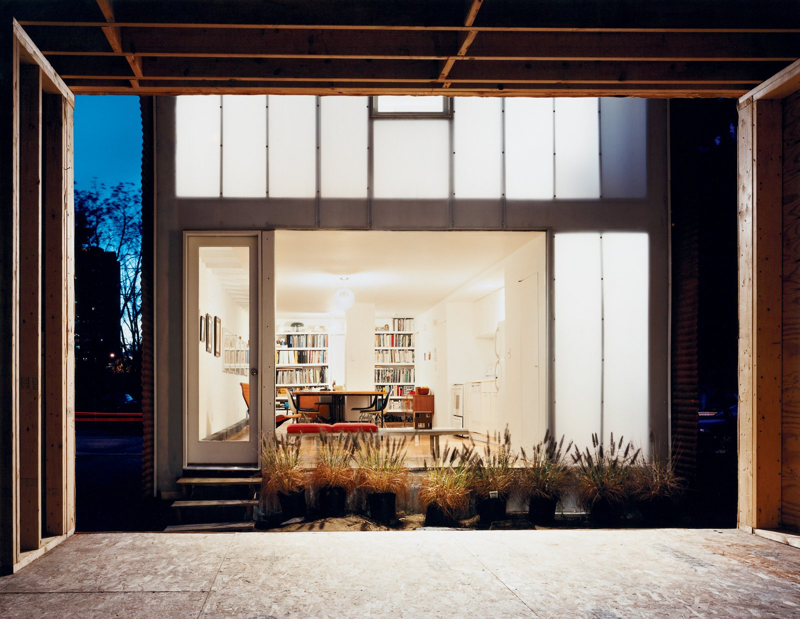 Now light emanates through the house's rear window, and through polycarbonate panels concealing the upstairs bedroom.  Photo 6 of 11 in New Beginnings
