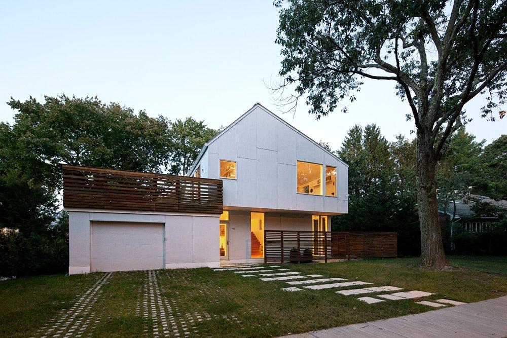 To maintain a sense of scale with regards to the lot, the Braver house was built up, down, and back. Through a series of split-levels, the previously one-story home is now three-and-a-half levels, with much of the new square footage reaching into the backyard.  The asymmetrical angle of the roof's pitch isn't architectural whimsy. Instead, it simultaneously hides an array of solar panels from view while optimizing its angle to the sun.  Photo 4 of 9 in Braver's New World