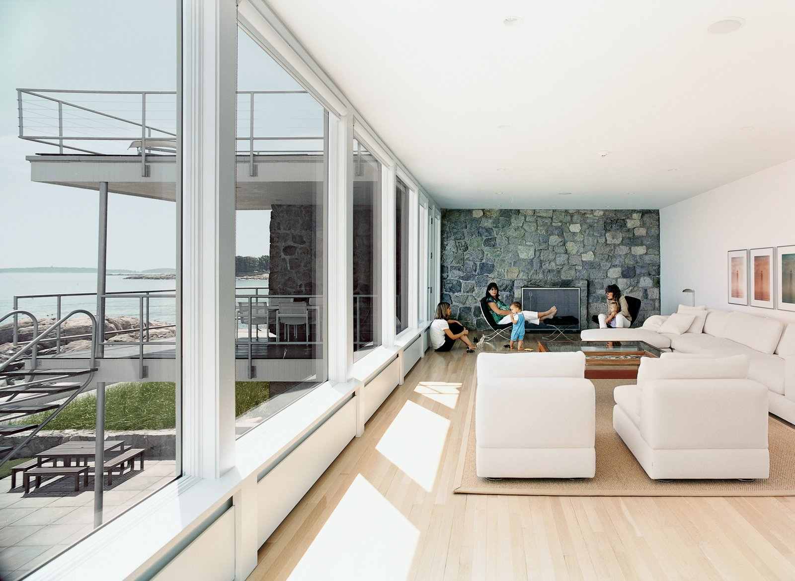 """Early on, the house's simplicity had great appeal to Jan Sasseen, the current owner. From walls to rugs to furniture, """"pretty much everything is white,"""" she says. """"When I was decorating, I picked the most basic things I could find. Nothing had details or frills.""""  Photo 5 of 8 in Bauhaus by the Sea"""