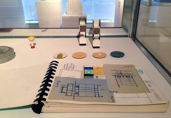 The sale, which is on view to the public through December 20, encompasses furniture, ceramics, metalwork, textiles and jewelry, alongside artworks, drawings, collages and a complete series of the self-published artists' and poets' books. Shown here is Sottsass's sketchbook paired with some miniature product prototypes.