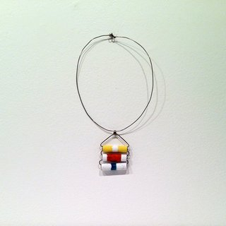 "Sottsass and Pivano made a habit of seeking out expressive travel jewelry, which they acquired on their extensive travels around the world. This enamel-on-copper pendant references a necklace from Papua New Guinea ""in which stacked bamboo batons would indicate the wealth and status of the wearer."""