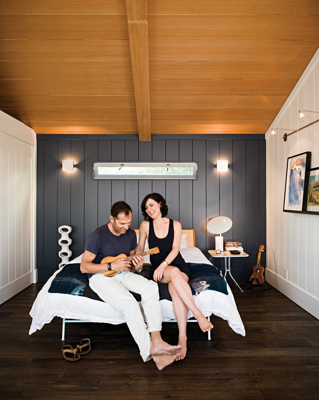 "Bedroom, Bed, and Dark Hardwood Floor ""There's a soulfulness in this small house that's impossible to replicate in something completely new. The sweetness truly lingers,"" says architect Michael Lee.   Bedrooms by Dwell from Less is More in this Manhattan Beach Bungalow"