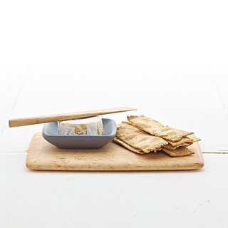 Warm wintry grey is a nod to the season in this Appetizer Set, which includes a mini condiment plate, and Edward Wohl cutting board and pate knife.